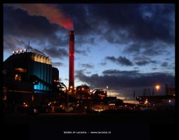 Factory at sunset by Leconte