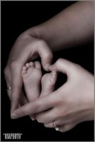 Baby in mothers hands.. by OsaPhoto