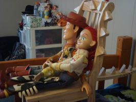 Woody and Jessie sitting on a Dragon Chair by spidyphan2