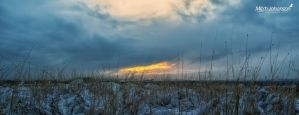 Snow Covered Grass and a Sunset by mjohanson