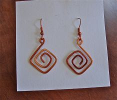 Hand hammered copper earrings, heat treated by jhammerberg