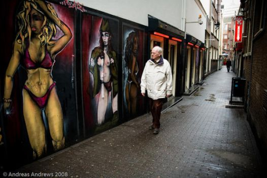 Old man in the red lights by andreasandrews