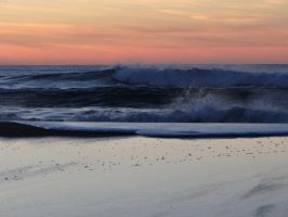 Rolling Waves at Sunset by Whimseystock