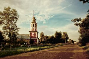 Red church at dawn and brown road by dSavin