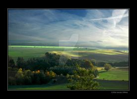 Sunlight playing on hills by grugster