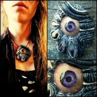 Amethyst eye 2 polymer clay pendant by dogzillalives