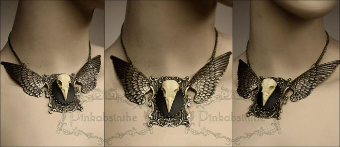 Chest tattoo moth winged skull necklace by Pinkabsinthe