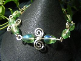 Iridescent Drops On Silver Spirals Bracelet by BacktoEarthCreations