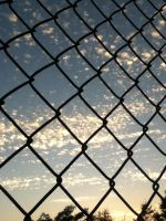 Through the fence is a beautiful sky by 1DarkAngel3