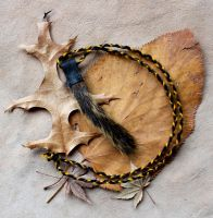 Squirrel Tail Necklace by lupagreenwolf
