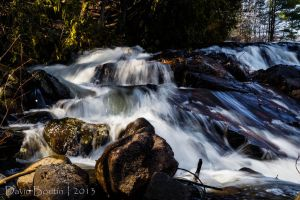 As the flow seduces the rocks by InOnesMindsEye