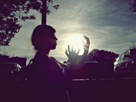 Holding the sun by ElithaPoke