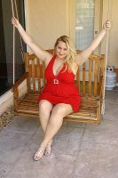 red dress on swing by CurvyKrista