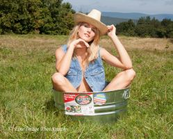 Cowgirl in a tub by fineimagephotography