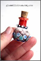 Red and blue miniature glass bottle by Faeriedivine