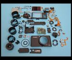 Canon S90 In Pieces by devianb