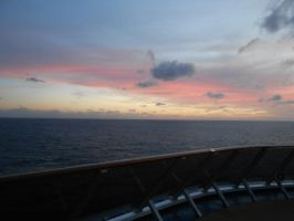 Pink Sunset over the Carnival Pride cruise ship by OceanRailroader