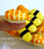 1 3 sushi on finger by Snowfern