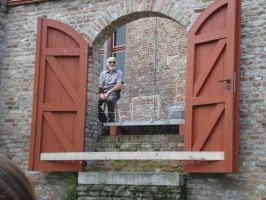 Bruges25 - Man on a Patio by Lutra-Gem