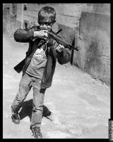 Child with machine gun (re edited) by PatriceChesse