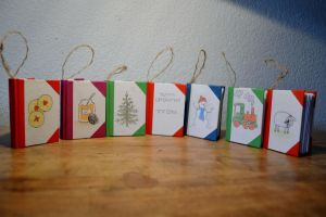 Miniature Book Christmas Ornaments by dragongirlhellfire