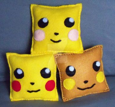 Pikachu Evolution Trio Pillows by moonphiredesign