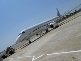 Airport tow truck and Embraer 190 by K4nK4n