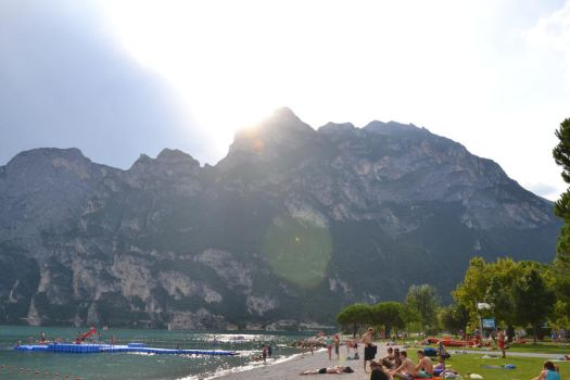 Riva del Garda Mountains with sun by korallenmaedchen