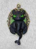 Toothless Polymer Clay sculpted pendant by Pandannabelle