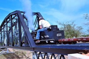 Steam engine crossing bridge by lawout16