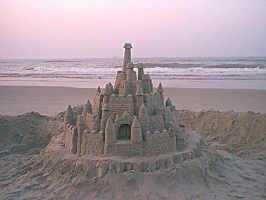 Sandcastle on Beach at Dawn by sage421