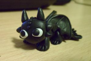 Tiny Toothless by delicioustrifle
