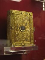 Gold covered book by DungeonStock