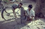 Rickshaw repairman, India by coshipi