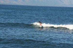 Surfer on the waves of Hawaii by Witch-Hunter-87