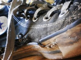 Old ripped converse shoes by Lisztomaniaa