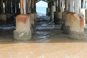 Low tide under the pier by drewii57