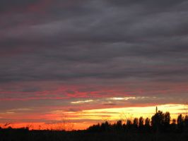 Cloudy Sunset by sztewe