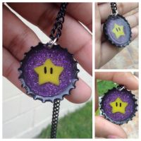 First try: recycled bottlecap, Mario star in resin by Saloscraftshop