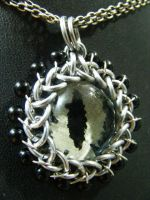 Glow in the dark eye in maille with onyx edging by BacktoEarthCreations