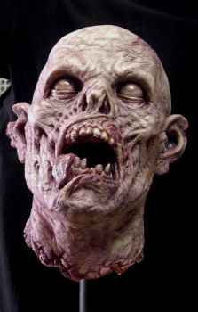 Severed zombie head by BOULARIS