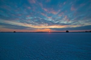 Winter icy sunset by LordHenkutt