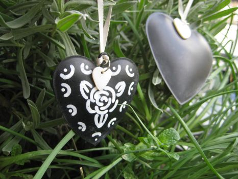 Tin hearts painted with blackboard paint by KymeraKirsty