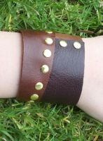 Asymmetrical Leather Cuff by salvagedsword