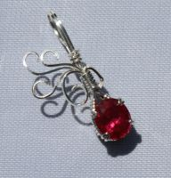 Sweet Red Topaz Pendant by skezzcrom