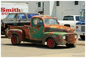 A Rusty Ford Truck With Red Wheels by TheMan268