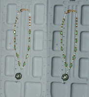 Green and Gold Y-ishNecklace by twig7998