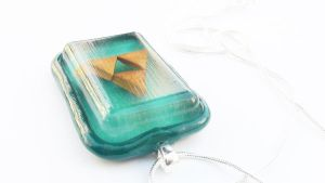 Green Triforce Necklace by WTFcharms