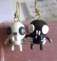 positive and negative earrings by OniBaka
