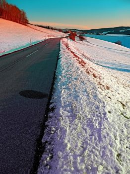 Winter road in vibrant colors by patrickjobst